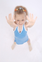 Girl shows five fingers.
