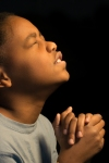 Praying African Americn boy